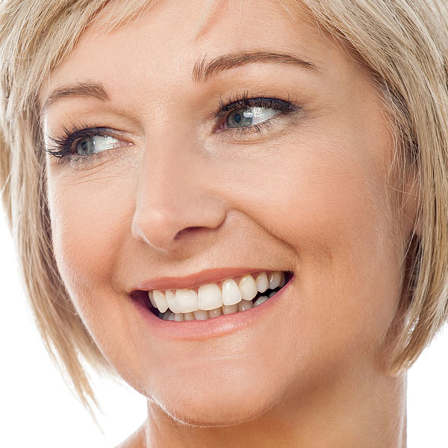 happy woman displaying microneedling results
